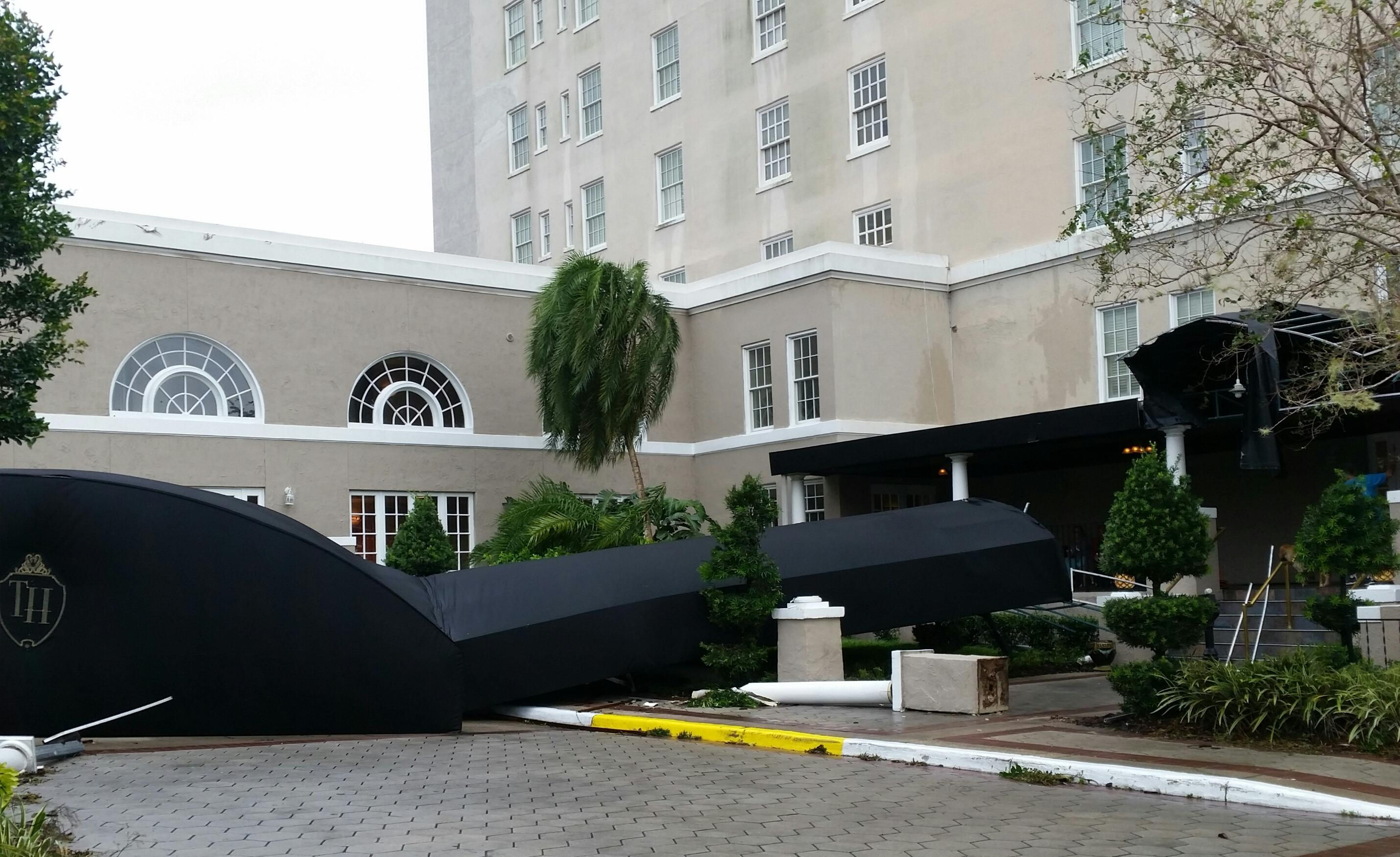 Broken hotel canopy due to storm damage